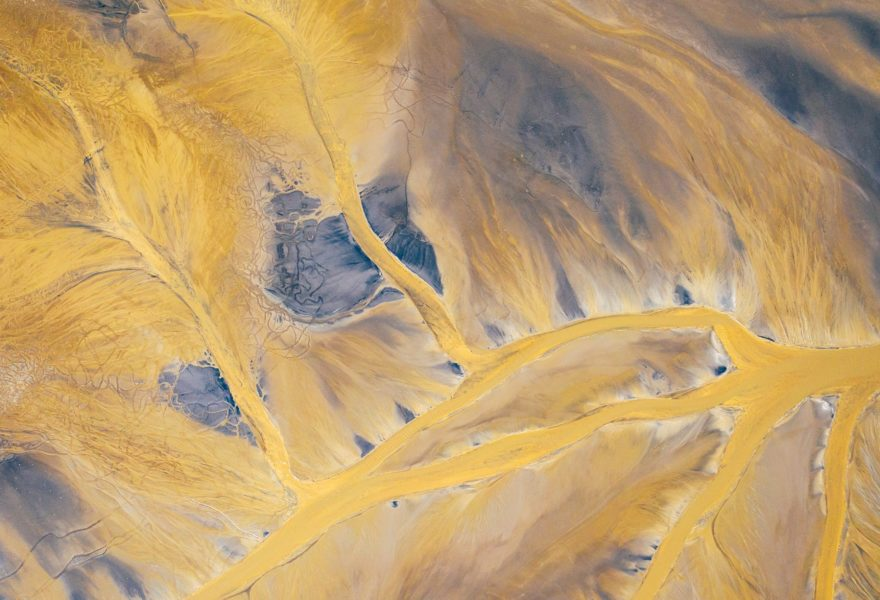 A dry barren landscape with random dry river tributaries